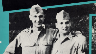 Two smiling men in army uniforms have their arms around each others shoulders in an old black and white image.