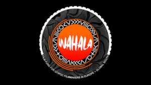 "A logo with an orange circle with black, white, and orange patterns around it on a black background. Text reads, ""Wahala"" and ""Film Fund for QTIPOC Filmmakers in Europe + Global South."""