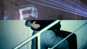 An image split into two with the top half a brick wall with lights projected onto it, and the bottom half an old style photo of someones ass as they embrass another person on some stairs.