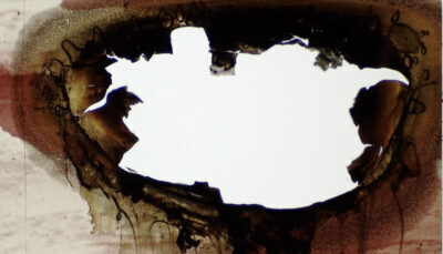 An abstract image, which looks like a painting, of a reddish brownish material with a hole burnt into it, exposing a plain white background behind it.